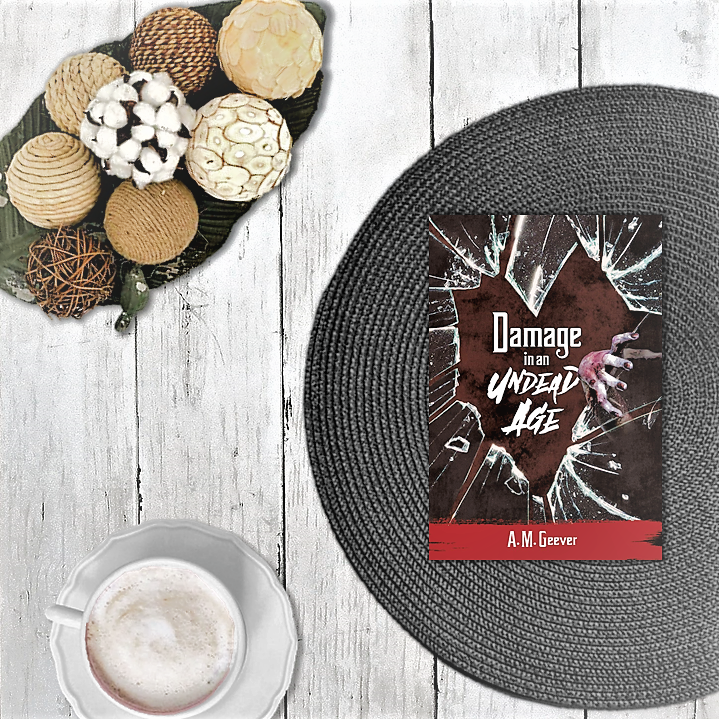 Book on place mat with coffee and decorative wicker balls.