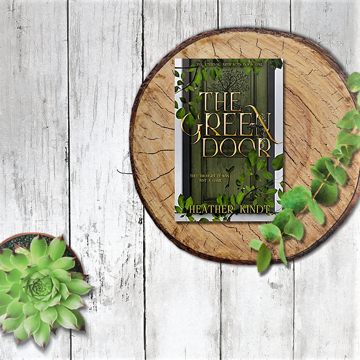 The Green Door book sitting on a wooden block with green leaves around it.