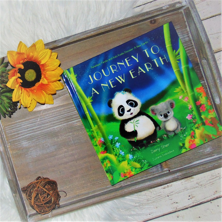 Book on wooden tray with flower