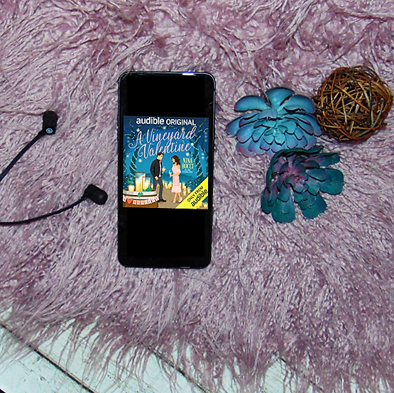 Audio book on phone with headphones and flowers