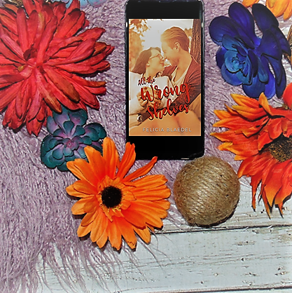 E-book on phone with flowers