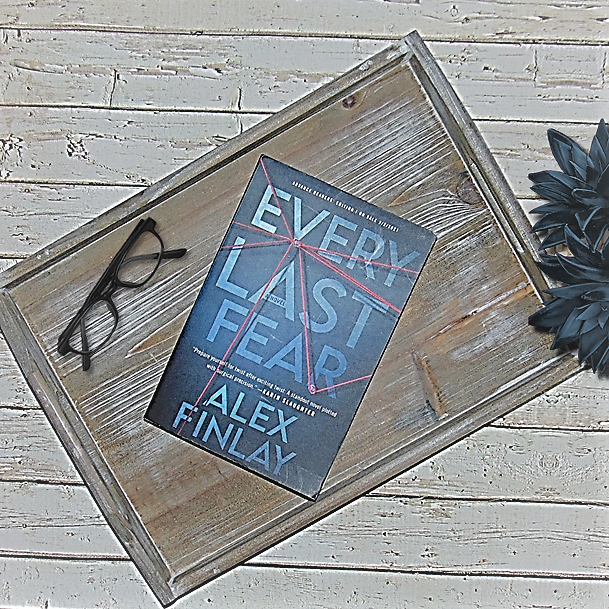 Every Last Fear book on wooden tray with glasses