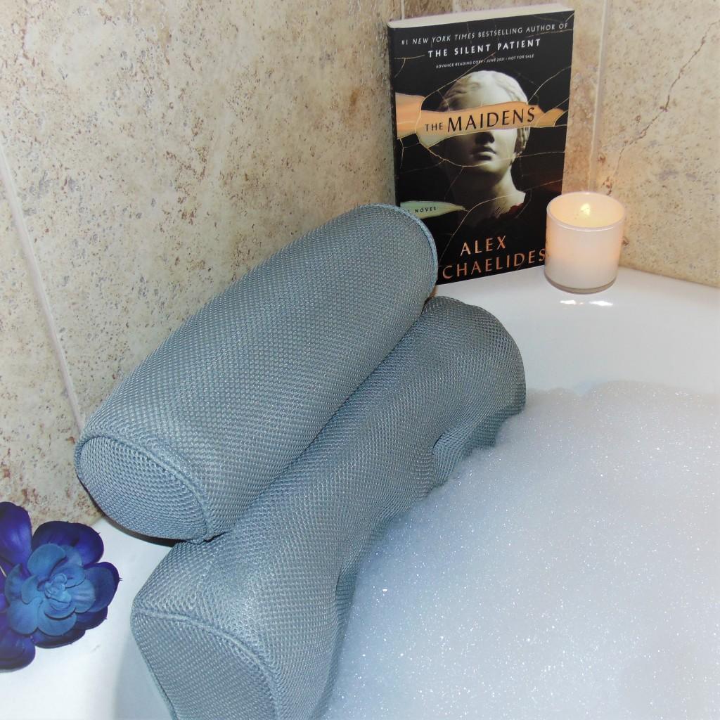 Book on bath ledge with bath pillow
