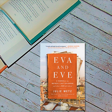 Eva and Eve Book on wooden background
