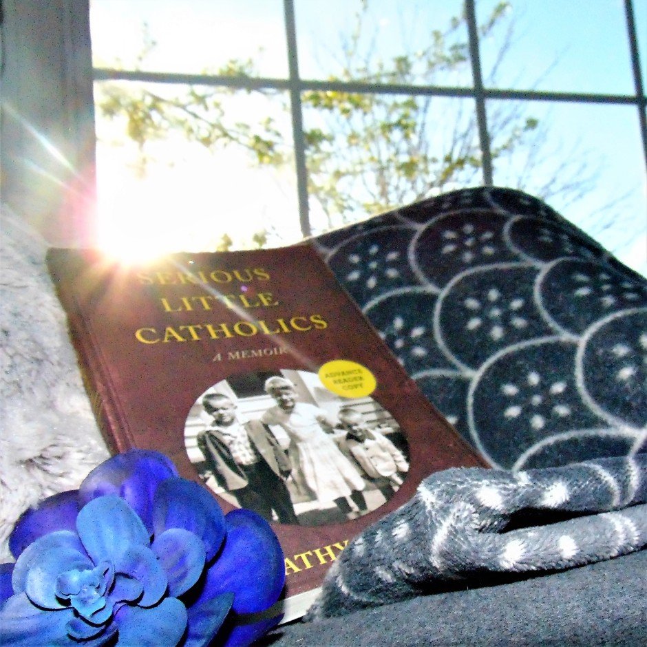 Serious LIttle Catholics on blanket with flower and sunshine