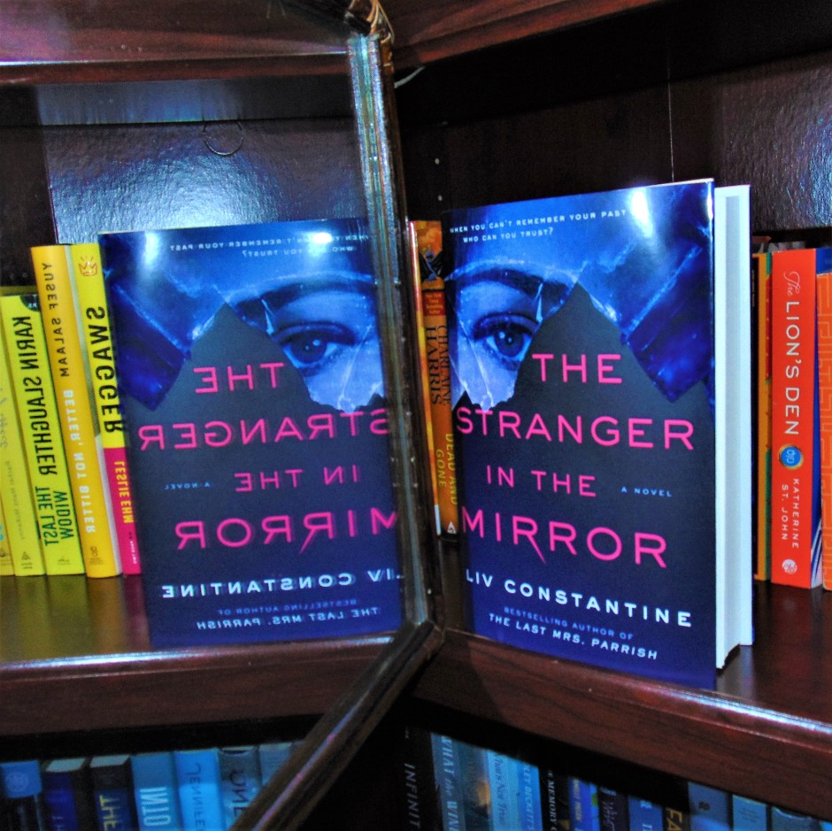 The Stranger in the Mirror book with a reflection in the mirror