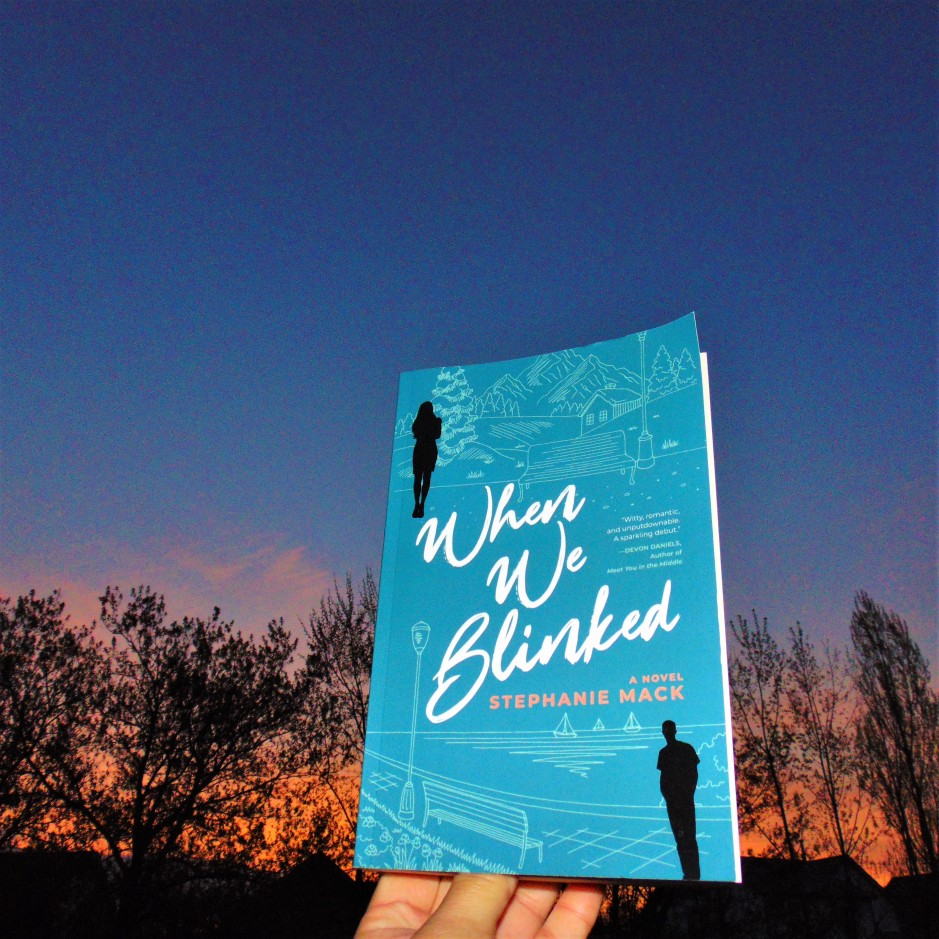 When We Blinked book in front of sunset with trees