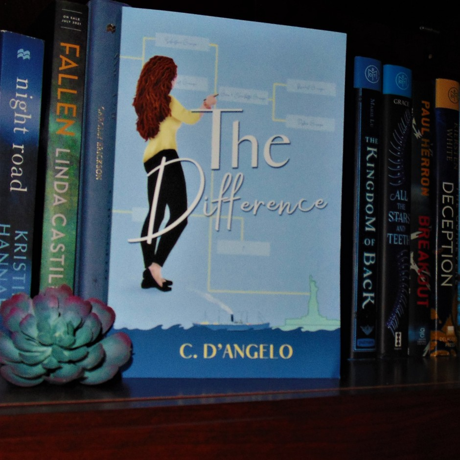 The Difference book on bookshelf with flower