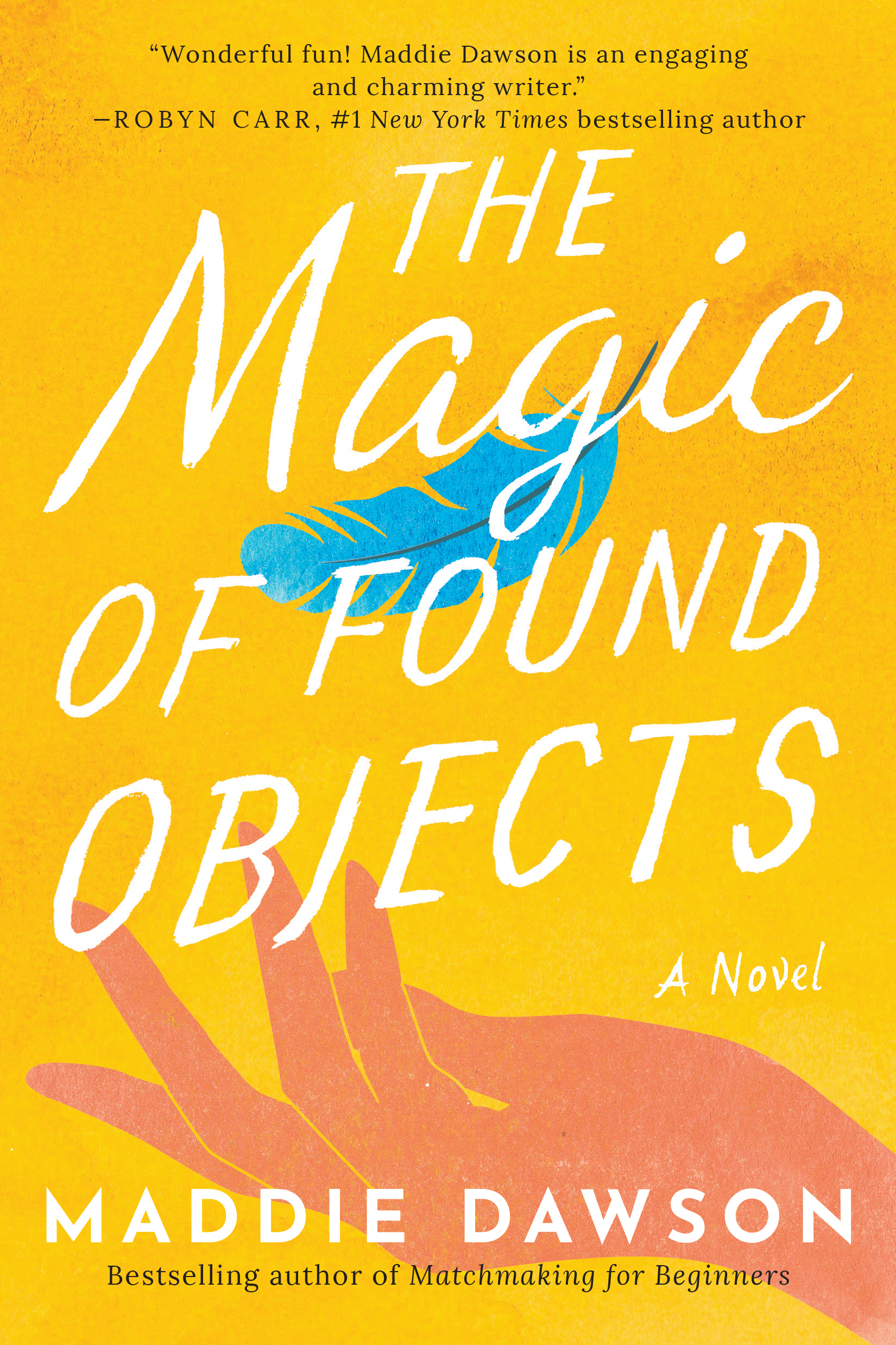 The Magic of found objects book cover with feather above hand