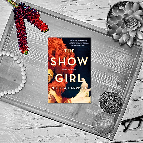 The Showgirl book on tray with necklace