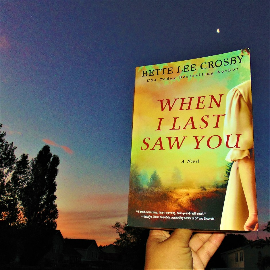 When I Last Saw You book held to sun rise with moon visible