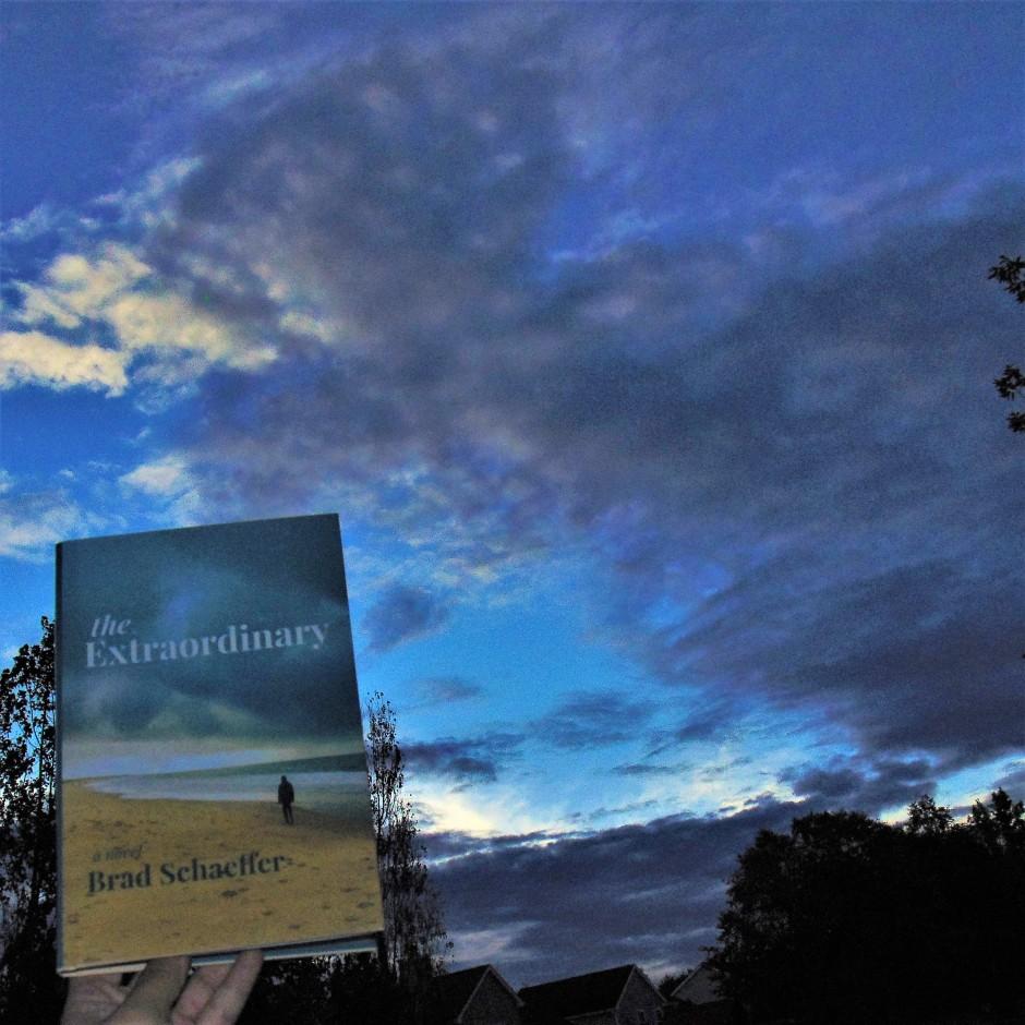 The Extraordinary book held to sky